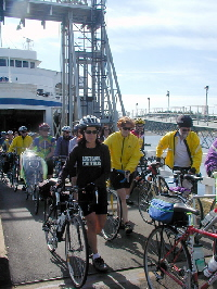 Click to enlarge image of cyclists disembarking ferry
