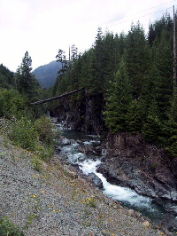 Click to enlarge image of rushing river (photo credit Charlie Buchalter)