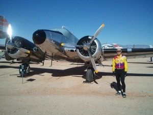 Spencer in front of a Beachcraft at the Pima Air & Space Museum